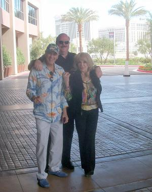 Ed Tucker in between Howard Mauer and Dyanne Thorne outside the Wyndham Desert Blue.