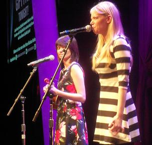 Kate Micucci and Riki Lindhome performing as Garfunkel and Oats.